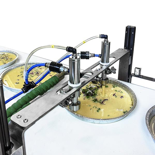 Dosing system with two-way valve on belt for the dosing of chickpea cake
